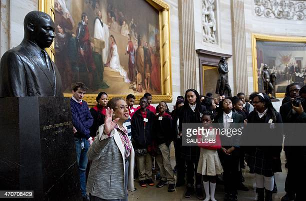 US Congressional Delegate Eleanor Holmes Norton of Washington DC speaks with students about Black History Month alongside a statue of Martin Luther...
