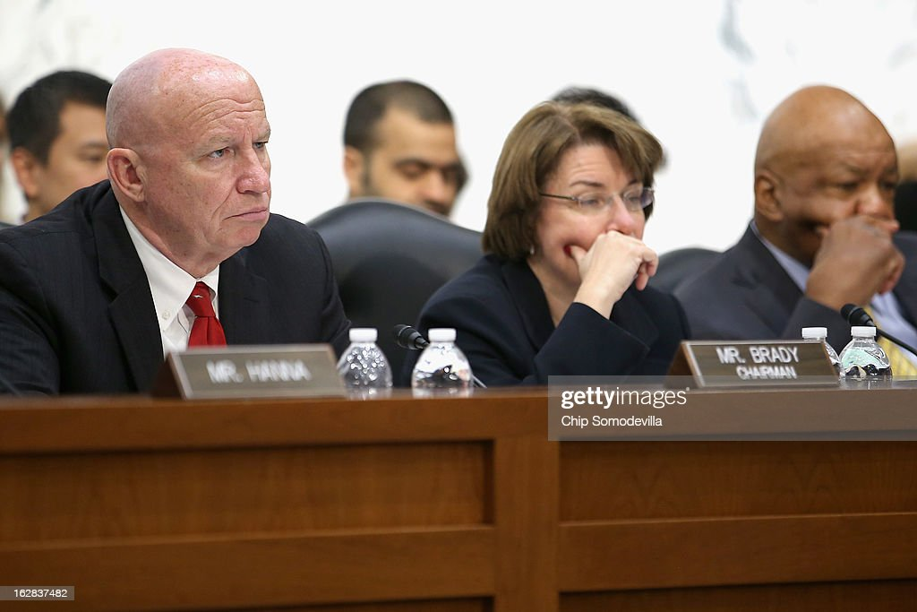 Congressional Joint Economic Committee Chairman Rep. Kevin Brady (R-TX), Co-Chair Sen. Amy Klobuchar (D-MN) and Rep. <a gi-track='captionPersonalityLinkClicked' href=/galleries/search?phrase=Elijah+Cummings&family=editorial&specificpeople=725911 ng-click='$event.stopPropagation()'>Elijah Cummings</a> (D-MD) hear testimony during hearing on Capitol Hill February 28, 2013 in Washington, DC. This was Brady's first hearing as chairman of the bipartisan and bicameral committee. The committee heard testimony from two former chairmen of the Council of Economic Advisers, Michael Boskin and Austan Goolsbee, who disagreed on the speed of the nation's economic recovery during the hearing, titled 'State of the U.S. Economy.'