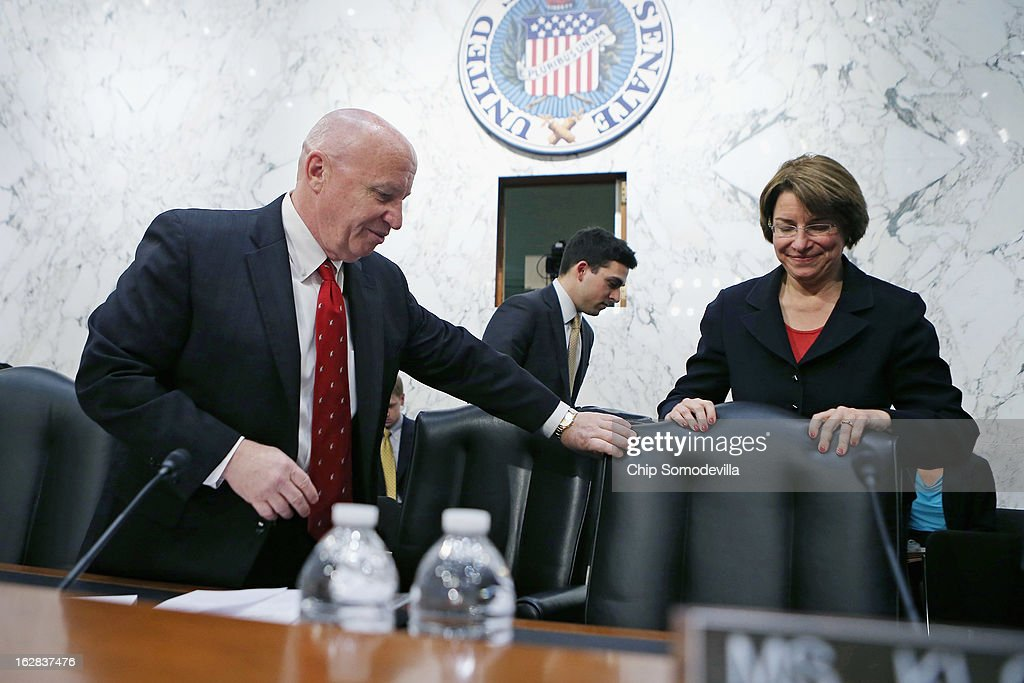 Congressional Joint Ecoomic Committee Chairman Rep. Kevin Brady (R-TX) (L) helps Co-Chair Sen. Amy Klobuchar (D-MN) with her chair before the start of a hearing on Capitol Hill February 28, 2013 in Washington, DC. This was Brady's first hearing as chairman of the bipartisan and bicameral committee. The committee heard testimony from two former chairmen of the Council of Economic Advisers, Michael Boskin and Austan Goolsbee, who disagreed on the speed of the nation's economic recovery during the hearing, titled 'State of the U.S. Economy.'