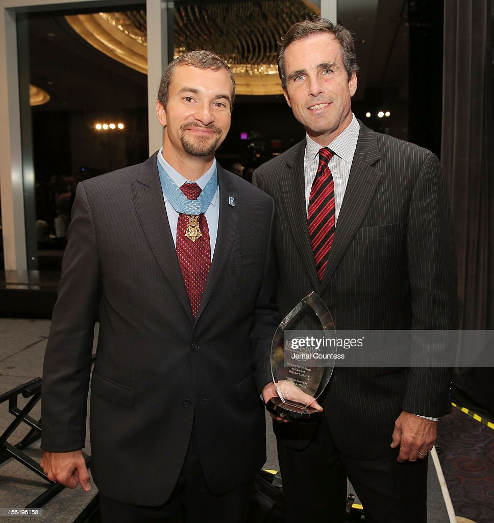 Congressional Medal of Honor Recipient and Honoree Sal Giunta and Journalist and Gala host <a gi-track='captionPersonalityLinkClicked' href=/galleries/search?phrase=Bob+Woodruff&family=editorial&specificpeople=785978 ng-click='$event.stopPropagation()'>Bob Woodruff</a> pose for photo during the 2014 'Working for Wellness And Beyond' Gala at Mandarin Oriental Hotel on October 1, 2014 in New York City.