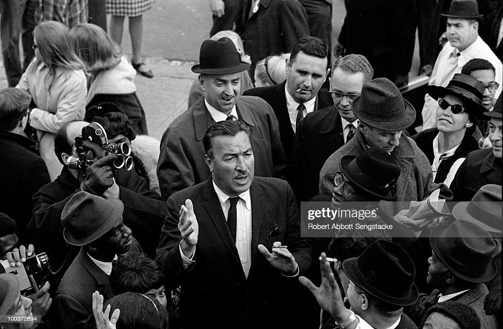 US Congressman Adam Clayton Powell, Jr. (1908 - 1972) arrives in Washington, D.C. to a crowd of supporters, police, and journalists, 1967. He was stripped of the chairmanship of the Education and Labor Committee, amidst allegations of misappropriation of committee funds.