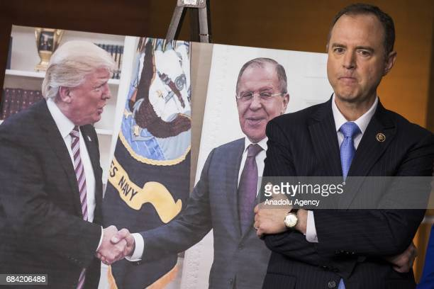 Congressman Adam Schiff Ranking Member of the House Permanent Select Committee on Intelligence stands next to a photo released by the Russian State...