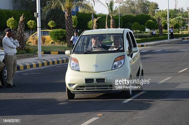 US Congressman and Republican member of the House of Representatives from Illinois Aaron Schock drives a TATA NANO car during the US delegation visit...
