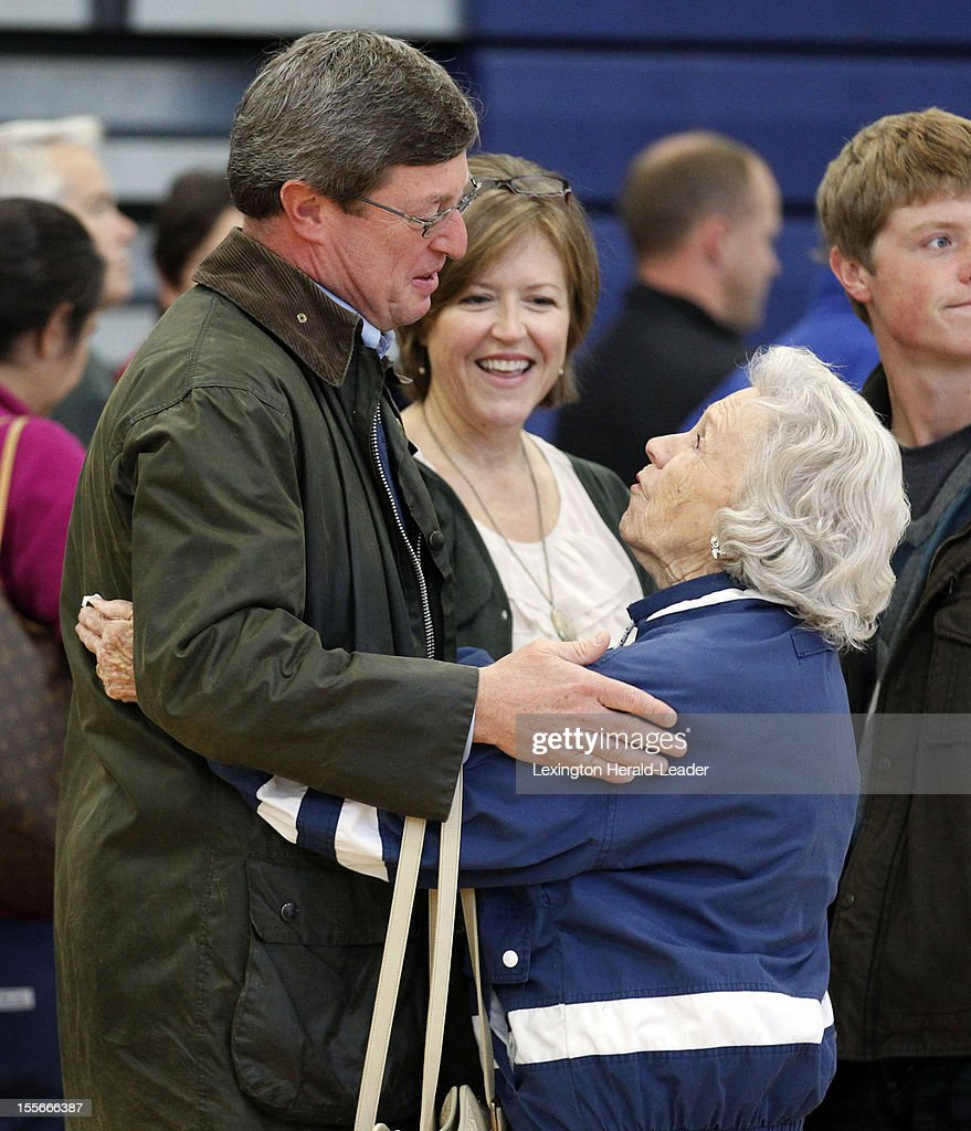 Congressman Ben Chandler, and his wife Jennifer, middle, greets Doris Moye as they arrive to vote at Huntertown Elementary School in Versailles, Kentucky, Tuesday, November 6, 2012. Chandler, a Democrat, is running for reelection in the 6th congressional district against Republican challenger Andy Barr and Independent Party challenger Randolph Vance. Doris said she has known Ben since he was born.