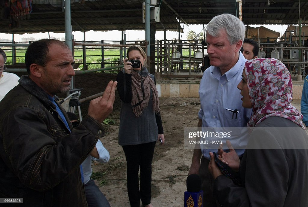 US congressman Brian Baird speaks with a Palestinian man during an inspection visit to the northern Gaza Strip on February 14 2010 Two US Democrat...