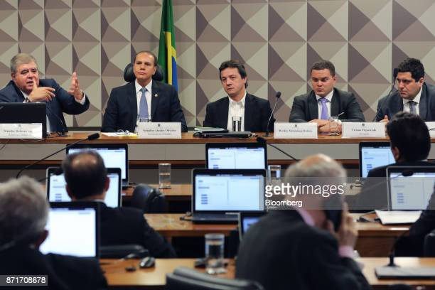 Congressman Carlos Marun from left speaks while Senator Ataides Oliveira Wesley Batista former chief executive officer of JBS SA Ticiano Figueiredo...
