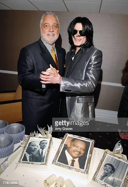 Congressman Danny Davis and singer Michael Jackson pose for a photo at the VIP Cocktail Reception hosted by Bombay Sapphire at Reverend Jesse...