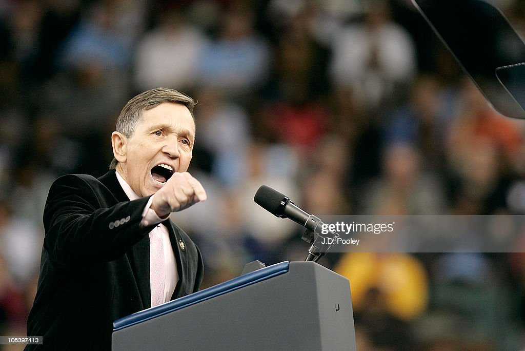 S Congressman Dennis Kucinich motivates a crowd waiting to hear US President Barack Obama and US Vice President Joe Biden speak during the...