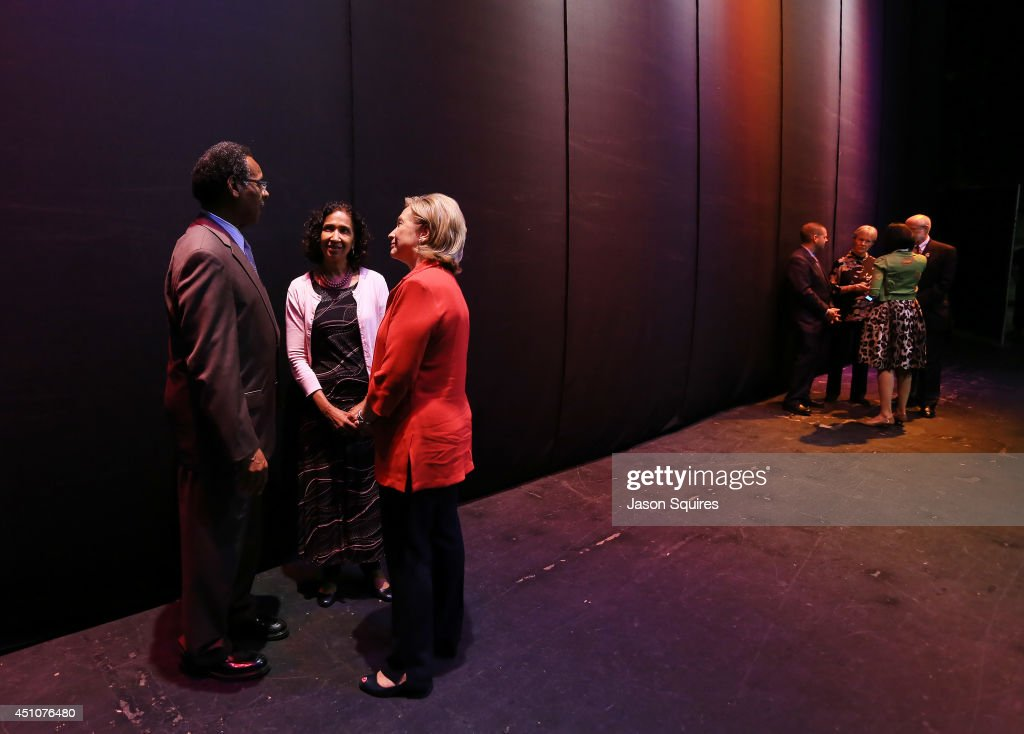 Congressman <a gi-track='captionPersonalityLinkClicked' href=/galleries/search?phrase=Emanuel+Cleaver&family=editorial&specificpeople=754349 ng-click='$event.stopPropagation()'>Emanuel Cleaver</a> and his wife Dianne speak with former US Secretary of State Hillary Rodham Clinton during Rainy Day Book Presents Hillary Rodham Clinton at Arvest Bank Theatre at The Midland on June 22, 2014 in Kansas City, Missouri.