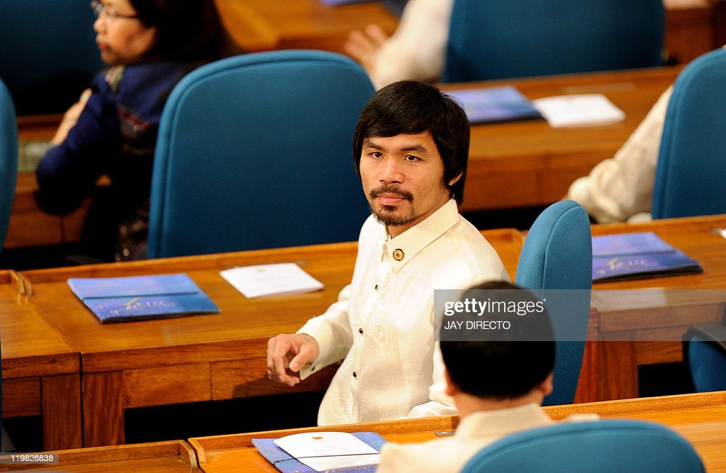 Congressman Filipino eightdivision world champion boxing hero Manny Pacquiao sits with fellow lawmakers during the 15th congress at the House of...