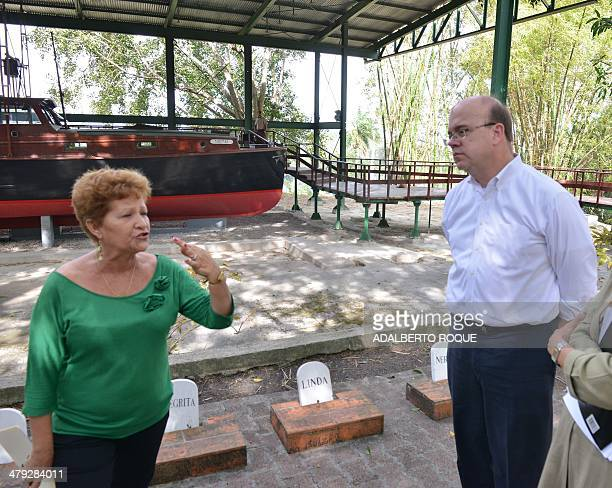 US congressman Jim McGovern listens to the principal of Hemingway's Museum Ada Rosa Alfonso during a visit to Ernest Hemingway's former home near...