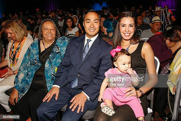 US Congressman Joaquin Castro poses for a photograph with his mother Rosie Castro wife Anna Castro and daughter during HBO Latino Habla Men at People...