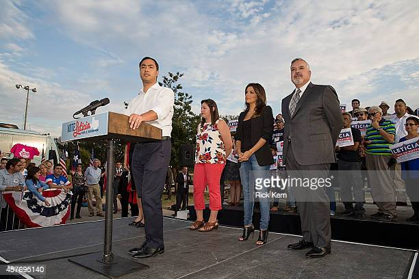 Congressman Joaquin Castro speaks as student Tiana Trejo Eva Longoria actor director producer and activist and Henry R Munoz III Latino activist and...