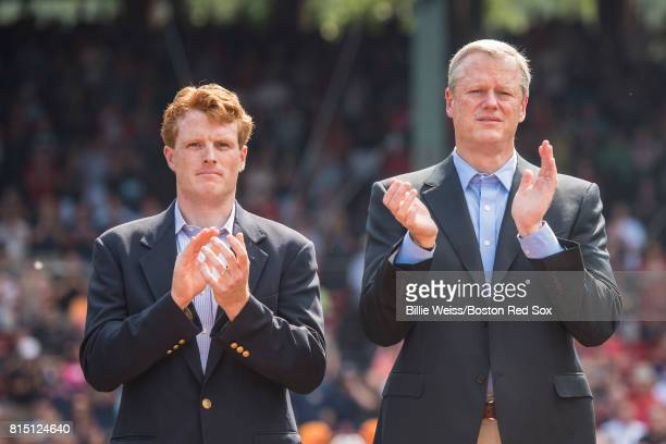 Congressman Joe Kennedy III and Massachusetts Governor Charlie Baker applaud during a ceremony honoring Vietnam Veterans before a game between the...