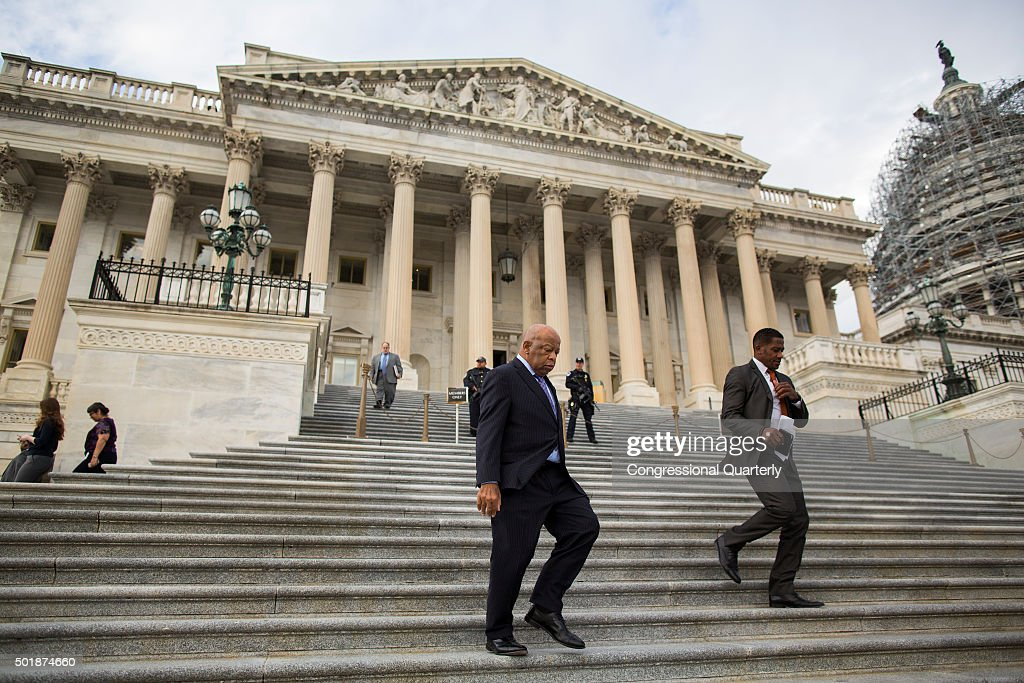 STATES DECEMBER 18 Congressman John Lewis DGa walks down the House steps with fellow lawmakers after the last scheduled vote of the year on Capitol...