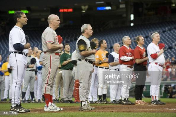 Congressman listen to the National Anthem before the 48th Annual Roll Call Congressional Baseball Game held at Nationals Stadium June 17 2009