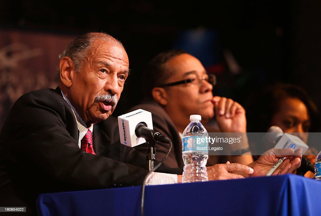 U.S. Congressman representing Michigan's 13th District Rep. John Conyers, Jr. (L) and Sheriff, Mayoral Candidate Sheriff Benny Napoleon speaks at Charles H. Wright Museum of African American History on September 16, 2013 in Detroit, Michigan.