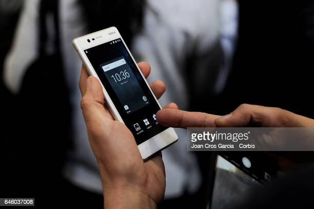 A congressman testing the new Nokia 3 during the Mobile World Congress on February 27 2017 in Barcelona Spain