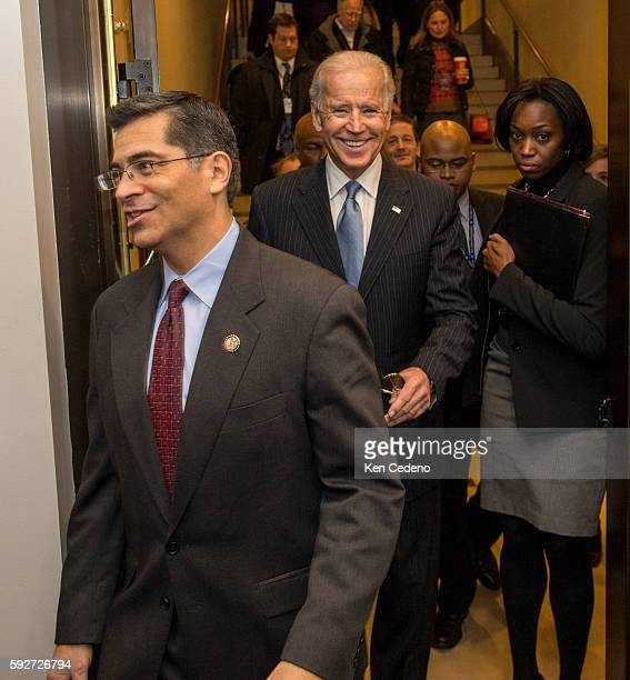 Congressman Xavier Becerra left and Vice President Joe Biden arrives for a House Democratic Caucus meeting for an unusual New Year's Day session to...