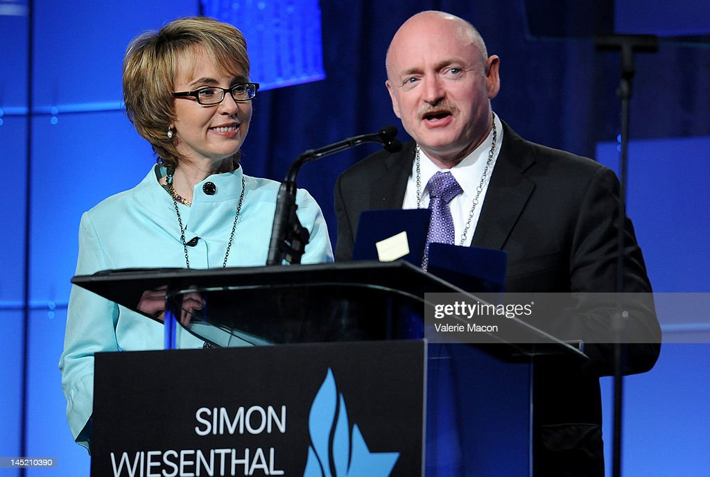 Congresswoman Gabrielle Giffords and husband astronaut Mark Kelly receive the medal of Valor at the Simon Wiesenthal Center's Annual National Tribute Dinner Honoring Jerry Bruckheimer at The Beverly Hilton Hotel on May 23, 2012 in Beverly Hills, California.