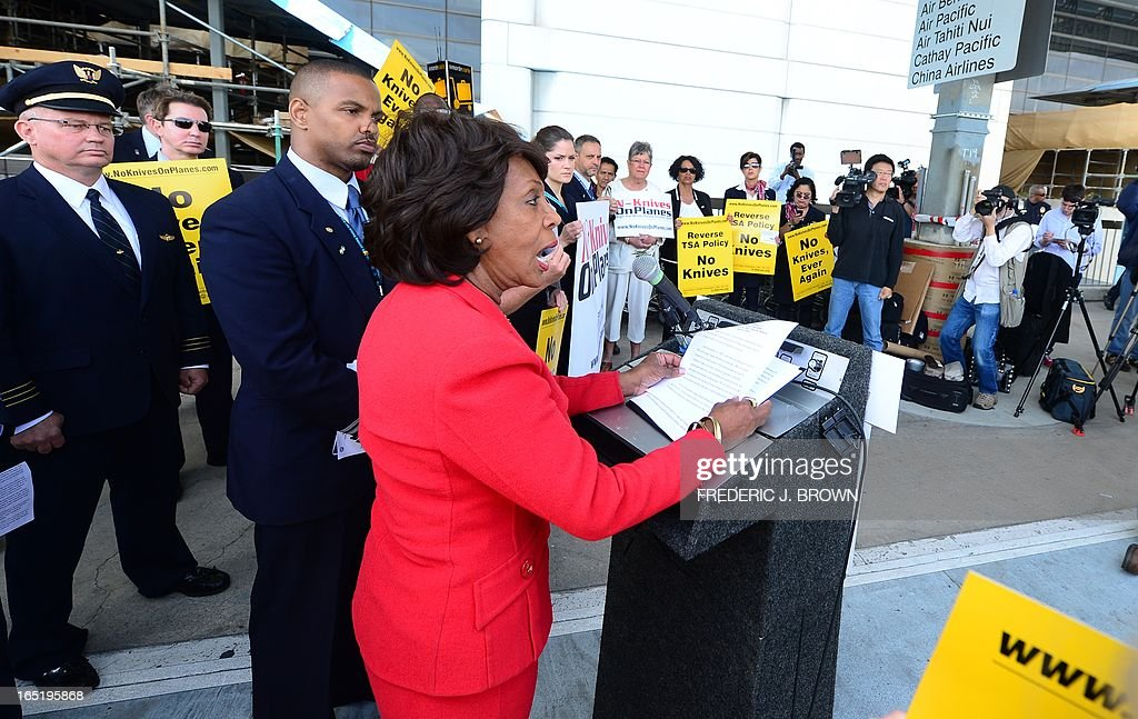 Congresswoman Maxine Waters speaks in suport of flight attendants and various employees for US airlines picketing at Los Angeles International Airport's departure level demanding that small knives be kept out of their cabins on April 1, 2013 in Los Angeles, California. The TSA recently announced plans to allow small pocket knives aboard planes, aiming to increase enforcement against larger potential weapons by not worrying about smaller implements. AFP PHOTO/Frederic J. BROWN