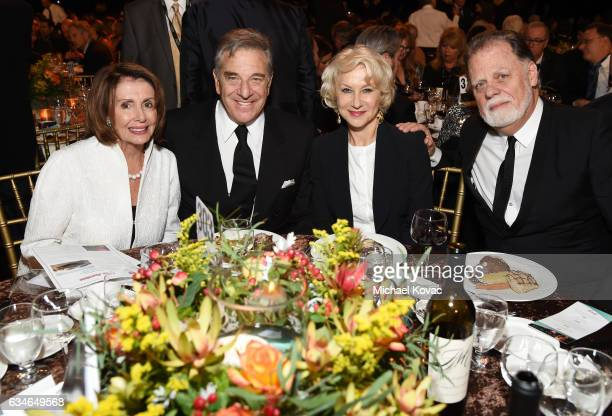 Congresswoman Nancy Pelosi businessman Paul Pelosi actress Helen Mirren and director Taylor Hackford attend MusiCares Person of the Year honoring Tom...