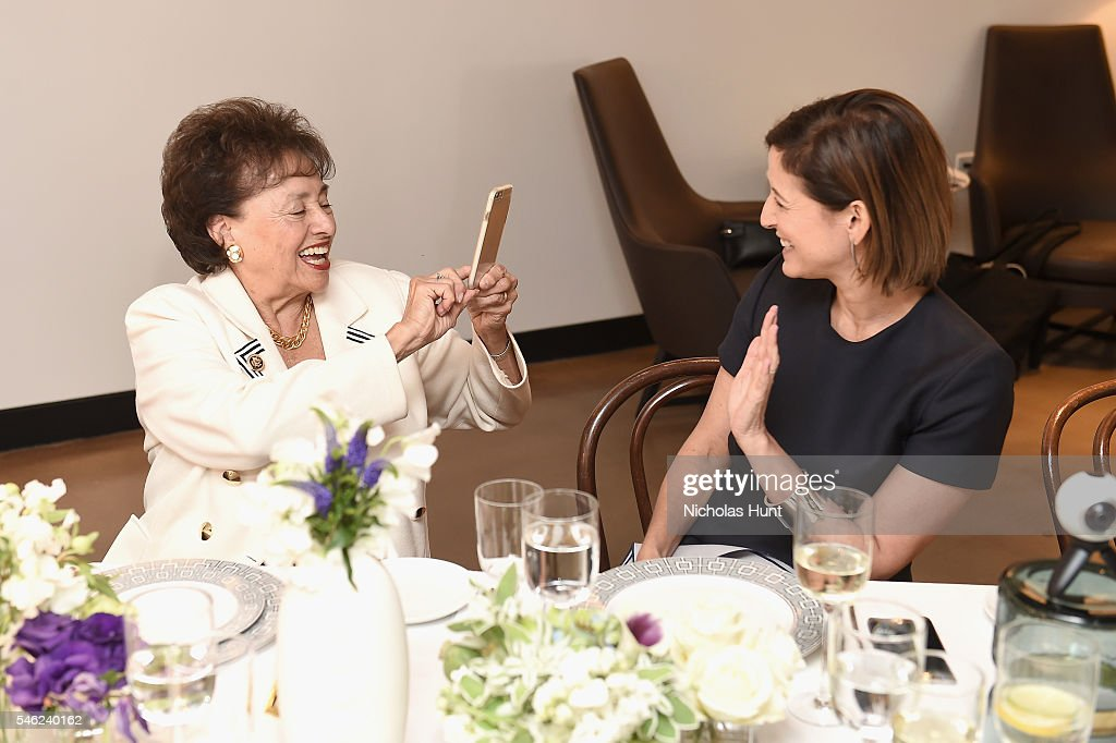 Congresswoman Nita Lowey takes a picture of Glamour editor in chief Cindi Leive during a luncheon hosted by Glamour and Facebook to discuss the 2016...