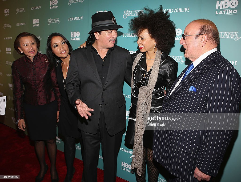 Congresswoman Nydia Velazquez, Lucinda Martinez, Carlos Santana, wife Cindy Blackman Santana and <a gi-track='captionPersonalityLinkClicked' href=/galleries/search?phrase=Clive+Davis&family=editorial&specificpeople=209314 ng-click='$event.stopPropagation()'>Clive Davis</a> attend the HBO Latino NYC Premiere of 'Santana: De Corazon' at Hudson Theatre on April 16, 2014 in New York City.