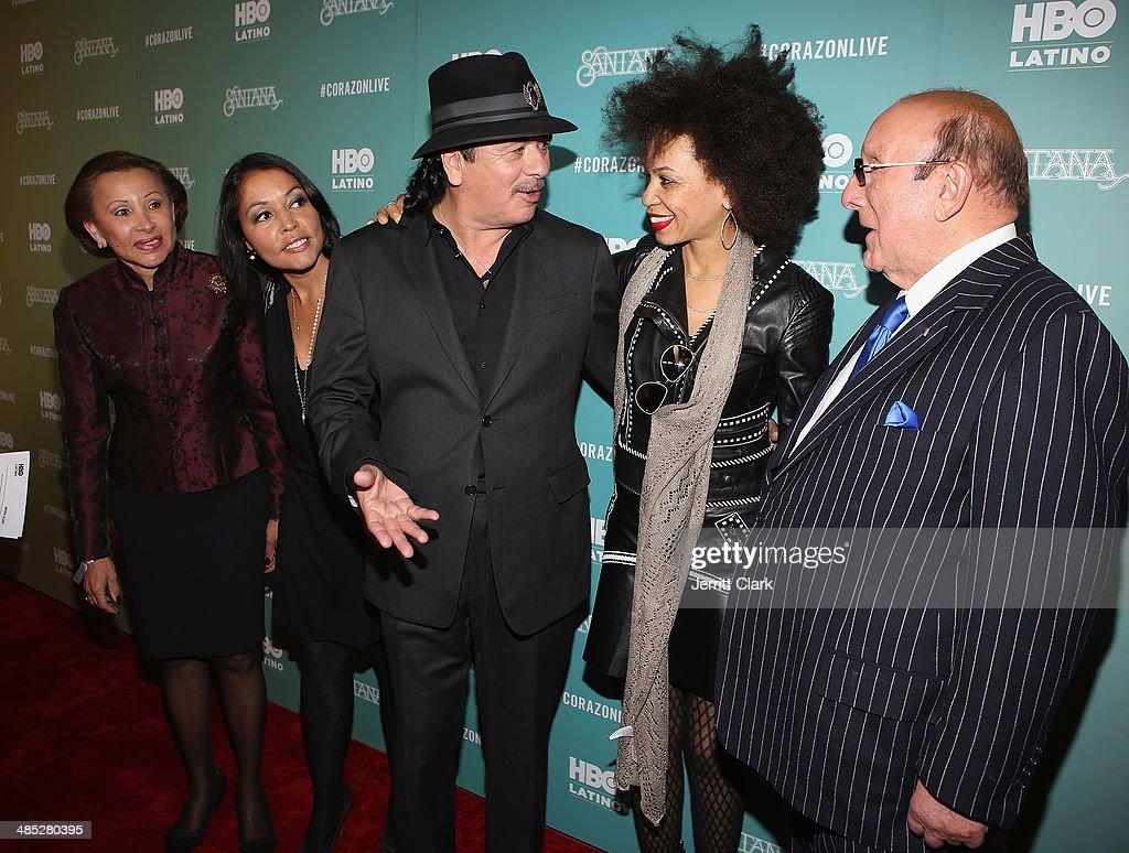 Congresswoman Nydia Velazquez, Lucinda Martinez, Carlos Santana, wife Cindy Blackman Santana and Clive Davis attend the HBO Latino NYC Premiere of 'Santana: De Corazon' at Hudson Theatre on April 16, 2014 in New York City.