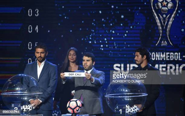 Conmebol Competitions' director Hugo Figueredo shows the name of Deportivo Cali during the Sudamericana Cup second round draw in Luque Paraguay on...