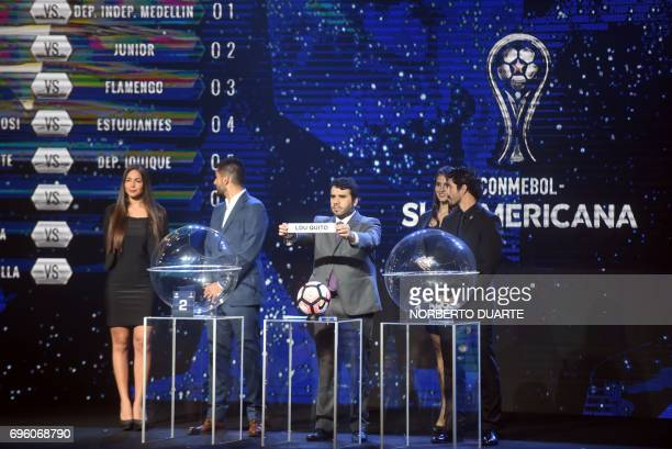 Conmebol Competitions' director Hugo Figueredo shows the name of Ecuador's LDU Quito during the Sudamericana Cup second round draw in Luque Paraguay...