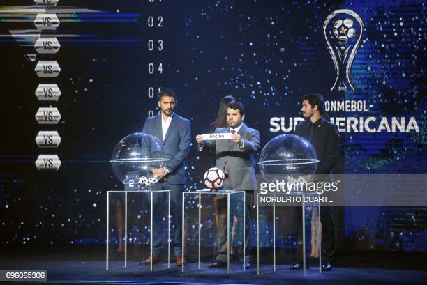 Conmebol Competitions' director Hugo Figueredo shows the name of Argentina's Racing during the Sudamericana Cup second round draw in Luque Paraguay...