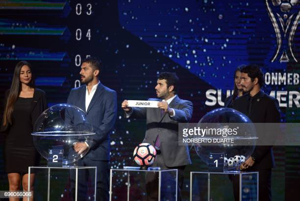 Conmebol Competitions' director Hugo Figueredo shows the name of Colombia's Junior during the Sudamericana Cup second round draw in Luque Paraguay on...