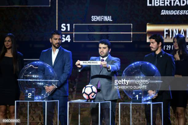 Conmebol Competitions' director Hugo Figueredo shows the name of Brazilian Palmeiras during the Libertadores Cup round of 16 draw in Luque Paraguay...