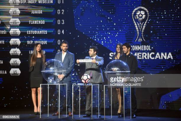 Conmebol Competitions' director Hugo Figueredo shows the name of Paraguay's Sol De America during the Sudamericana Cup second round draw in Luque...