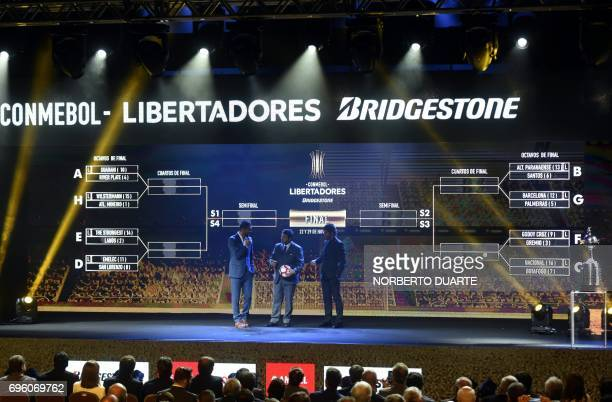 Conmebol Competitions' director Hugo Figueredo stands in front of the screen showing the fixture after the Libertadores Cup round of 16 draw in Luque...
