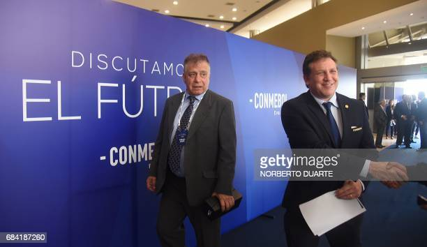 Conmebol president Alejandro Dominguez and former footballer Hugo Ever Almeida arrive at the Conmebol headquarters in Luque Paraguay on May 17 2017...