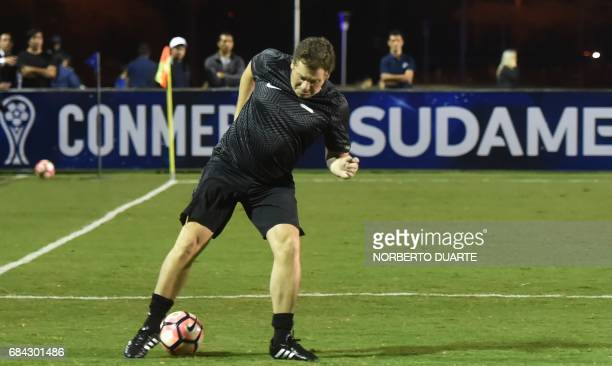 Conmebol's president Alejandro Dominguez controls the ball during a friendly football match in Luque Paraguay on May 17 2017 in the framework of a...