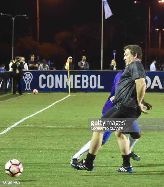 Conmebol's president Alejandro Dominguez plays during a friendly football match in Luque Paraguay on May 17 2017 in the framework of a meeting at the...