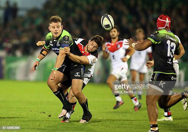 Connacht's Australianborn Irish prop Finlay Bealham clears the ball during the European Cup rugby union pool match between Connacht Rugby and...