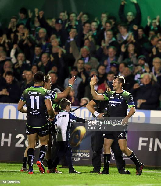 Connacht's players celebrate at the final whistle during the European Cup rugby union pool match between Connacht Rugby and Toulouse at The...