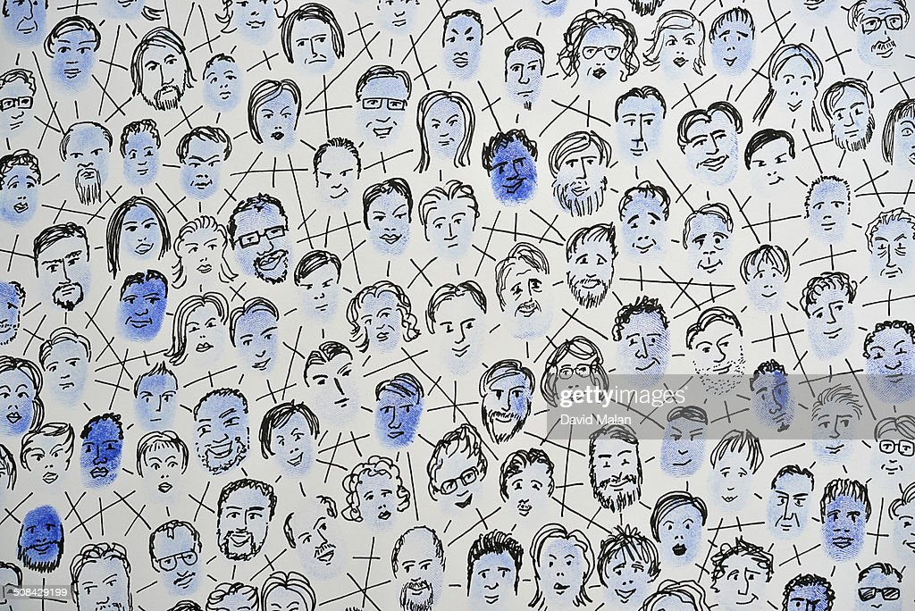 Connected fingerprints with faces drawn on them : Stock Photo