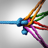 Connected group concept as many different ropes tied and linked together as an unbreakable chain as a community trust and faith metaphor for dependence and reliance on trusted partners for team and te