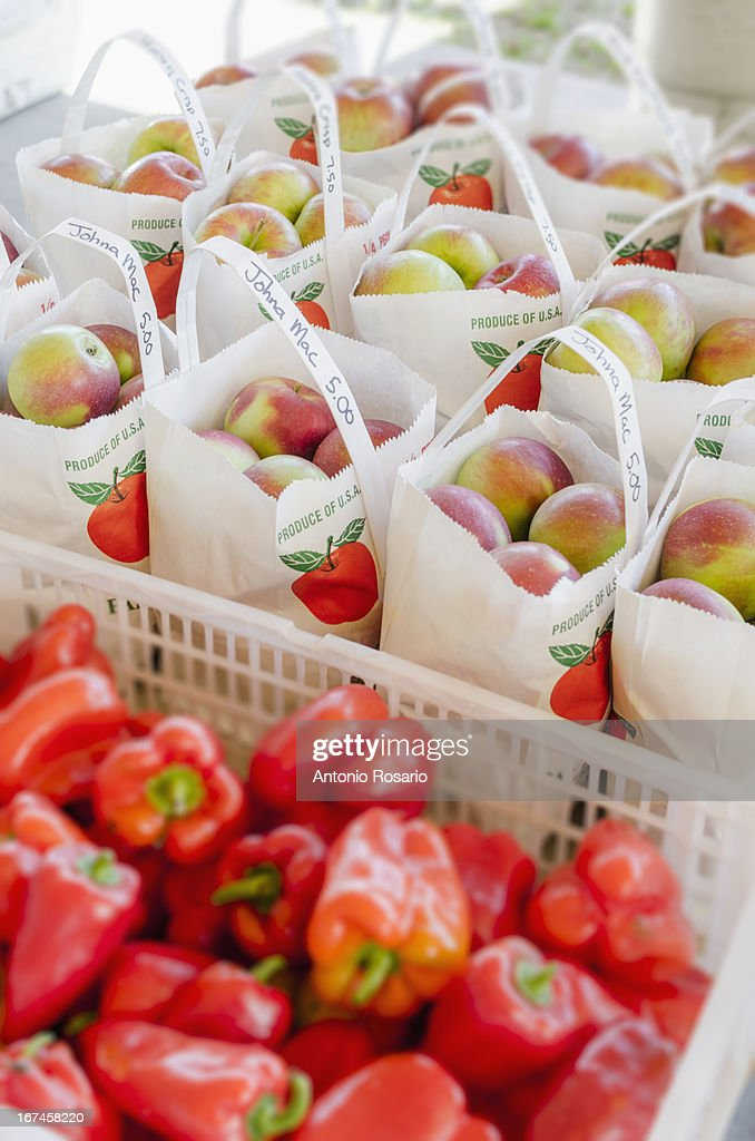 USA, Connecticut, Apples and red peppers ready to be bought : Stock Photo