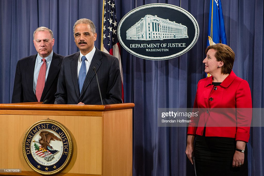 Connecticut Attorney General George Jepsen, U.S. Attorney General <a gi-track='captionPersonalityLinkClicked' href=/galleries/search?phrase=Eric+Holder&family=editorial&specificpeople=1060367 ng-click='$event.stopPropagation()'>Eric Holder</a>, and Acting Assistant Attorney General of the Antitrust Division Sharis A Pozen (L-R) announce an anti-trust lawsuit filed against Apple at the Department of Justice on April 11, 2012 in Washington, DC. Apple is accused of setting the price of e-books artifically high.