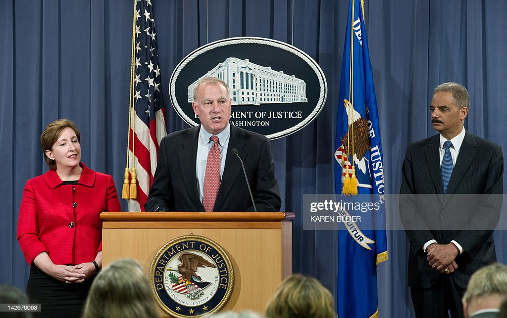 Connecticut Attorney General George Jepsen (C), with Acting Assistant Attorney General for the Antitrust Division Sharis A. Pozen (L) and US Attorney General Eric Holder, announces a significant antitrust settlement on April 11, 2012 during a press conference at the Justice Department in Washington, DC. Three publishing houses reached a settlement Wednesday with US antitrust authorities after the Justice Department sued Apple and five publishers for conspiring to raise the price of e-books. Hachette Book Group, HarperCollins and Simon & Schuster reached a settlement but the case will proceed against Apple and the other two -- Macmillan and Penguin Group -- 'for conspiring to end e-book retailers' freedom to compete on price,' the Justice Department said. AFP PHOTO/Karen BLEIER