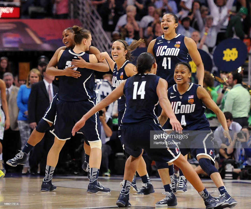 Connecticut celebrates the Huskies' 83-65 win over the Notre Dame Fighting Irish in the women's NCAA semifinal in New Orleans, Louisiana.