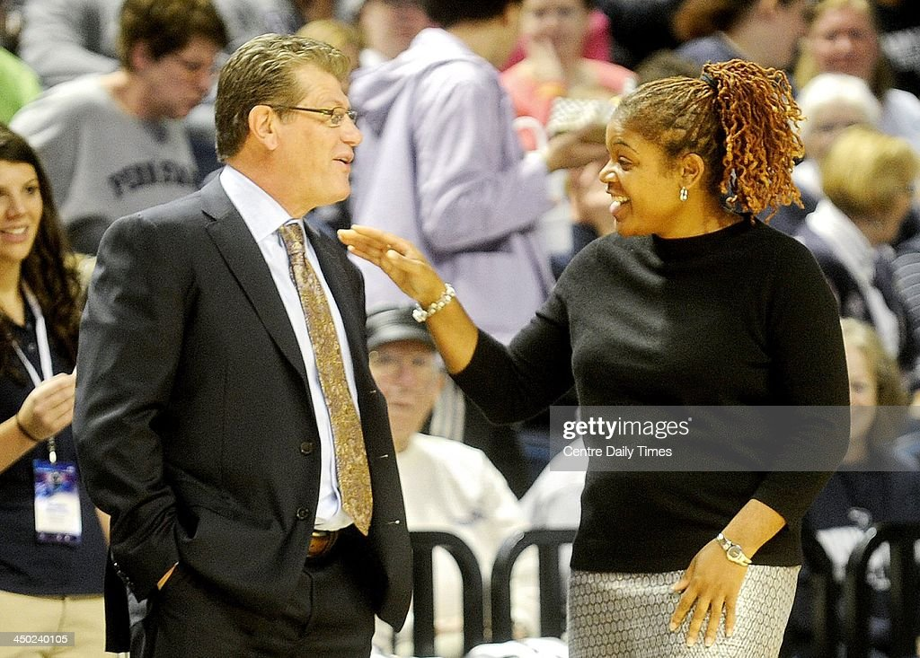 Connecticut coach Geno Auriemma chats with Penn State coach Coquese Washington before the game at the Bryce Jordan Center in State College, Pa., Sunday, Nov. 17, 2013.