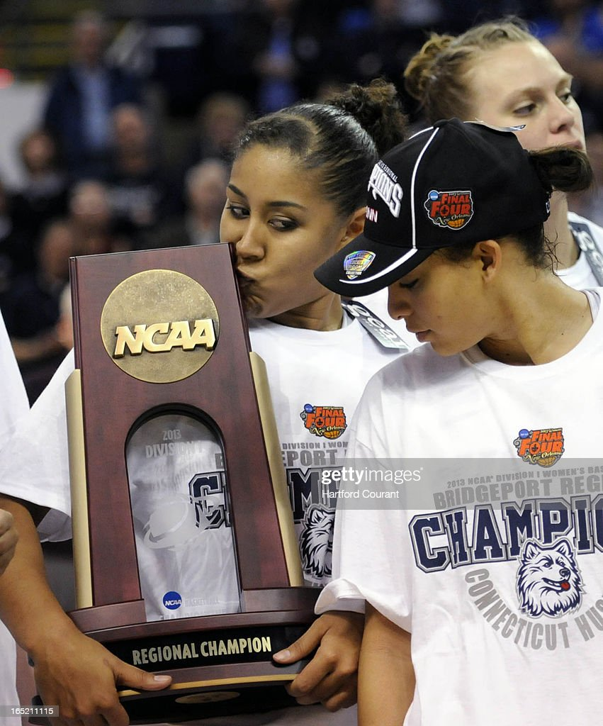 Connecticut forward Kaleena Mosqueda-Lewis (23) kisses the NCAA Regional Championship trophy after the Huskies defeated Kentucky, 83-53, in their Elite Eight game at Webster Bank Arena in Bridgeport, Connecticut, Monday, April 01, 2013. UConn won, 83-53.