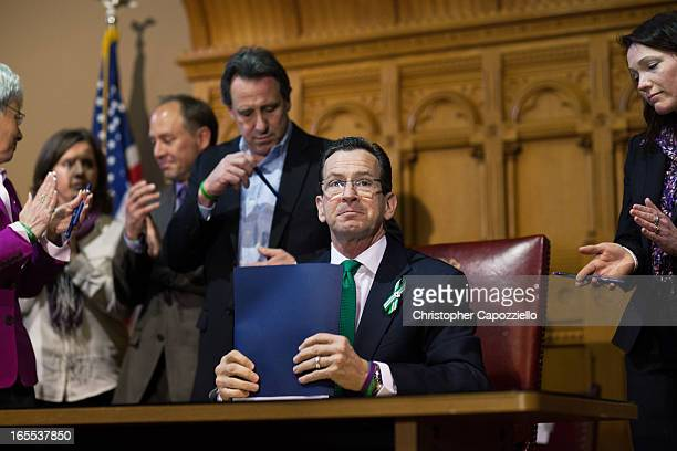 Connecticut Gov Dannel Malloy looks up after signing a guncontrol bill April 4 2013 in Hartford Connecticut After more than 13 hours of debate the...